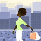 Dark-skinned woman shopping in the city Royalty Free Stock Photo
