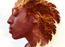 Double exposure portrait combined with incredible fractal artwork. Dark skinned young man with a peaceful expression combined with feather like fractal shining Royalty Free Stock Photos