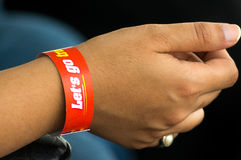 Dark skinnned man with inspirational wrist band. Dark skinned man with an inspirational wrist band given during a racing event Stock Images