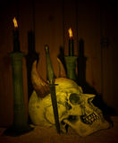 Dark Skull. With two candles Royalty Free Stock Image