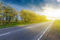 Dark sky asphalt road Royalty Free Stock Photo