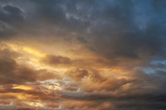 Dark sky with blak clouds brings storm rain at the sunset Royalty Free Stock Photos