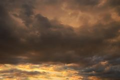 Dark sky with blak clouds brings storm rain at the sunset Stock Images