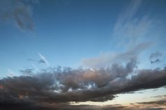Dark sky with blak clouds brings storm rain at the sunset Royalty Free Stock Photography