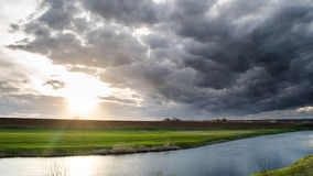 Dark sky. Dark clouds in the view o river Stock Image