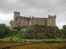 Dark sky at Dunvegan Castle (Scotland UK). General view of the Dunvegan Castle, during a dark and cloudy day (Scotland, UK Stock Images