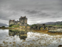 Dark sky at Eilean Donan Castle. Eilean Donan is a small island in the western Highlands of Scotland Stock Images