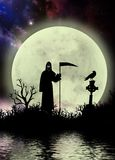 Dark sky with grim reaper fantasy moonscape stock photography