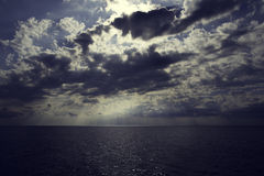 Dark sky with heavy clouds over the sea Stock Photo