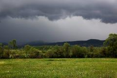 Dark sky during a heavy thunderstorm Stock Photos