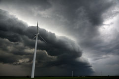Dark sky and high winds threatening wind turbines Royalty Free Stock Photo
