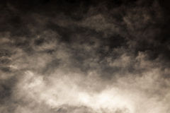 Dark Sky. Light brown tone like smoke on black Stock Images