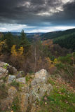 Dark sky over a beautiful rock formation (Rocher de Falize) in Belgium. A beautiful rock formation (Rocher de Falize) in the Belgium Ardennes during autumn Royalty Free Stock Photography