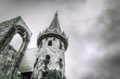 Dark sky over the castle. Dark cloudy sky over the old stone castle Stock Photography