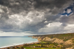 Dark sky over coastline Stock Photo