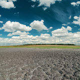 Dark sky over cracked desert Royalty Free Stock Images