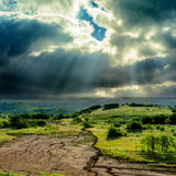 Dark sky over mountain with erosion Stock Images