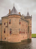 Dark sky  over Muiderslot Castle in the Netherlands Royalty Free Stock Photography