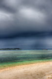 Dark sky over the ocean, the Small island of GILI Indonesia. Of the Indian ocean Stock Images