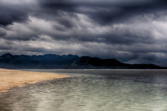 Dark sky over the ocean, the Small island of GILI Indonesia. Of the Indian ocean Stock Photography