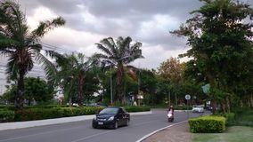 Dark sky before rain and traffic in little city,thailand stock footage