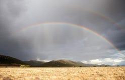 Dark sky with a rainbow Stock Photography