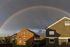 Dark sky with rainbow in Germany Royalty Free Stock Photo