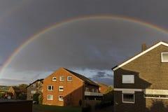 Dark sky with rainbow in Lower Saxony, Germany Stock Photography