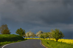 Dark sky. Spring landscape with a path before the storm Stock Photo