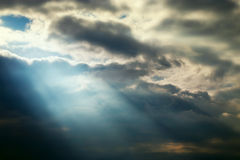 Dark sky stormy clouds and blue lighting effects stock image