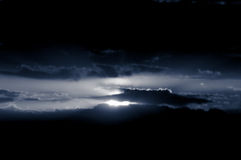 Dark Sky Sun. Sun shining through dark clouds Stock Photography
