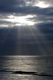 Dark sky sun rays Stock Photos