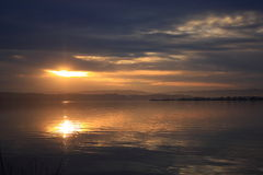 Dark sky over the water in Sunset  Royalty Free Stock Photos