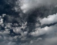 Cumulus clouds gather in the sky before a thunderstorm. Dark sky and thick clouds before a thunderstorm stock photography