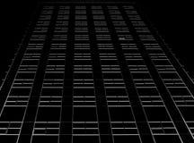 Dark skyscraper. Light windows corners stock photography
