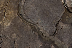 Dark slate. Abstract background of dark coloured, red, blue and purple slate with ridgelines and fine grain Stock Image