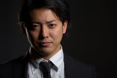 Dark and Smiling Asian Male Portrait Royalty Free Stock Photo