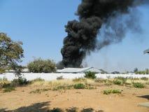 Dark Smoke. Over Rundu state house Stock Image