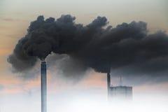 Dark smoke from chimneys Stock Images
