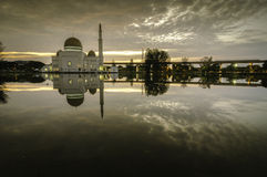 Dark and soft image of the mosque with reflection on the lake Stock Photos