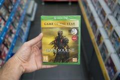 Dark Souls 3 The Fire Fades edition videogame on XBOX One. Bratislava, Slovakia, circa april 2017: Man holding Dark Souls 3 The Fire Fades edition videogame on Royalty Free Stock Image