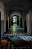 Dark spooky corridor in an old abandoned hospital buiding with s Stock Photography