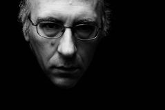 Dark and spooky face. Beautiful theactrically lit image of mans face with eyeglasses Royalty Free Stock Image