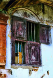 Dark and spooky windows. The half opened window with dark grungy on an abadoned desolated house on a street side of Jew Street,Kochi,Kerala Royalty Free Stock Photography