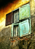 Dark and spooky windows. The half opened window with dark grungy on an abadoned desolated house on a street side of Jew Street,Kochi,Kerala Stock Photo