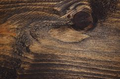 Dark stained, grain and knots in wood Royalty Free Stock Image
