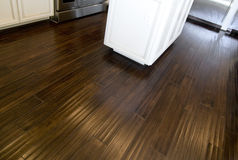 Dark stained hardwood flooring. New dark stained hardwood flooring in kitchen area of new home Stock Photos