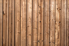 Dark stained wooden fence. Royalty Free Stock Photo