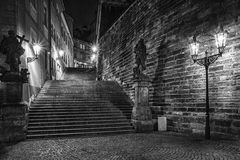Dark stairs. With two statues enlightened historical lanterns in black & white design Royalty Free Stock Photos