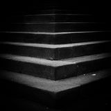 Dark stairway. A geometric view of a dark stairway Stock Images